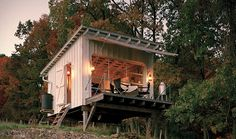 In true self-reliant style, this off grid tiny house relies on its own water and heat, including rainwater collection for showers and oil lamps for light.  http://www.tinyhousewebsites.com