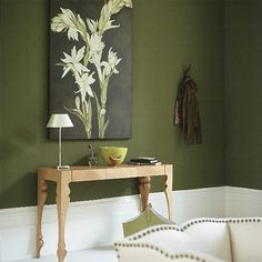 love the color of this wall with the crisp white trim.