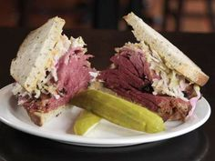 #4: Pastrami on Rye — Kenny & Zuke's Delicatessen : Think you'll find the best pastrami in New York? Think again. New York transplant Kenny Gordon has recreated the classic pastrami sandwich in Portland, Ore. Everything is made from scratch, including the rye bread and coleslaw. The pastrami is treated to a brine for a week before it's rubbed down with a special spice blend and smoked over oak for 11 hours. It's so popular that the restaurant sells 1,500 pounds of pastrami every we...
