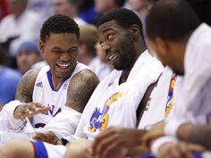 Kansas teammates Ben McLemore and Elijah Johnson joke on the bench late in the second half ~ 12.15.12