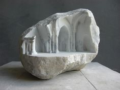 "British sculptor Matthew Simmonds creates intricately detailed small-scale sculptures out of marble and stone.  ""Making a play of architectural spaces on a small scale, the solid stone into which the sculptures are carved is opened up to reveal intricate internal worlds in which the changing viewpoint and light play a strong role in defining the sculptures.  Inspired by a life-long fascination of stone buildings, and drawing on skills learnt as an architectural stone carver, Simmonds"