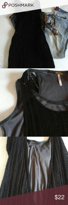 Flash Sale!!!  Free People Tank Top size S EUC, looks brand new.The gray ribbed tank has a long knit black net structure tank over it. The two tanks are sewn together at the shoulder seam. The black tank is about 7 inches longer than the gray tank at 30 inches. The black tank has a very deep armhole as shown in the 3rd picture. Please note the model in the stock picture has the tank tucked in in the front. Free People Tops Tank Tops