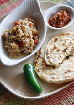 Baigan Choka. Trini dish that consists of roasted eggplant, garlic and tomatoes mashed up with onions and peppers. Usually eaten with roti/pita bread. Soo good