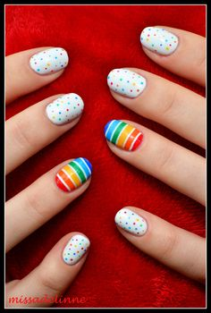 Colourful rainbow dot manicure with rainbow accent nail.  Not sure if I like the stripes AND dots, but one or the other would be great.