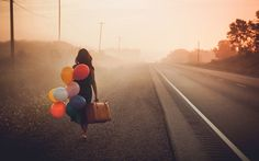 Not with the balloons, but if we use a suitcase you could hold a crown and/or a book in the other hand as well?