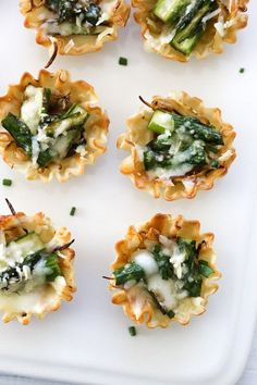 Asparagus and Caramelized Onion Tartlets make a tasty appetizer for Easter! These bite-sized asparagus tartlets are SO so good, made with a combination of Lunch Snacks, Clean Eating Snacks, Eating Healthy, Lunches, Pastry Shells, Yummy Appetizers, Easter Appetizers, Appetizer Recipes, Salads
