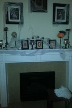 My dollar store Halloween mantel.