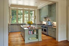 Big windows, mostly concealed range hood, workable island. Love this kitchen.