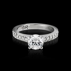 The Fulgeo engagement ring is a twist on the classic solitaire design, for those wanting a little more bling. The diamond band features approximately 16 full cut diamonds. Diamond Bands, Diamond Cuts, Wedding Bands, Diamonds, Bling, Engagement Rings, Classic, Jewelry, Design