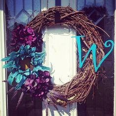 Wreath with last name initial on it! #purpleandturquoise