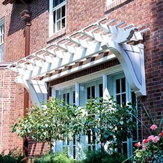 over-the-door pergola to add architectural interest to a traditional, formal home exterior.