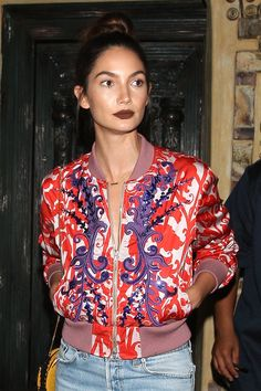 Lily Aldridge pairs a neatly painted matte chocolate lip with a swirl of bronzer and an easy topknot.