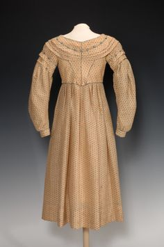 Child's Dress, Late 1830′s, wool, L 35in. The Fenimore Art Museum, Cooperstown, New York, Gift of Sylvia Brown Hills, N0231.1946. Photograph by Richard Walker.