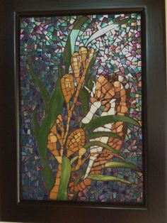 Stained glass mosaic seahorse, resting in the sea grass in a luminescent ocean background.