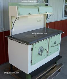 Links to website with new wood cook stoves.  Love this green and white one.