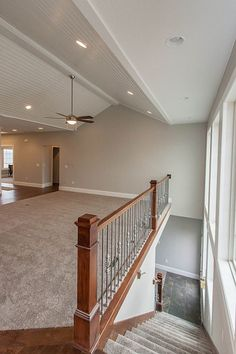 Open concept staircase to basement with wall of windows. option for staircase to basement in front of windows