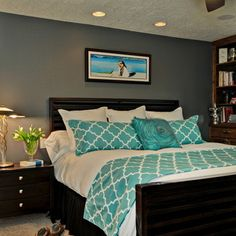 Grey bedroom feature wall + turquoise accents ....love the color palate. I also like the idea of taking a lap blanket and making matching pillows for the bed.