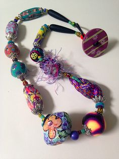 Polymer clay, paper mâché and fiber. by beadunsupervised, via Flickr by carol beal