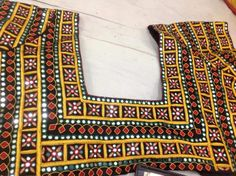 Top Beautiful Mirror work Blouse Designs Latest designs :- Mirror work blouse designs have become fashion now. When a mirror work blouse is combined with a plain saree it will give stunning a… New Embroidery Designs, Hand Work Embroidery, Embroidery Patterns, Mirror Work Saree Blouse, Mirror Work Blouse Design, Kutch Work Designs, Plain Saree, Beautiful Mirrors, Blouse Designs