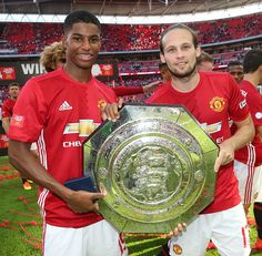 Marcus Rashford and Daley Blind of Manchester United pose with the Community Shield trophy after the FA Community Shield match between Leicester City...