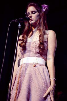 Lana Del Rey performing pink dress flower crown long red/auburn curled hair eyes closed
