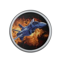 Military fighter plane flying out of fire bluetooth speaker. Bump up the volume of your favorite jams with the Bumpster, a portable speaker by OrigAudio. Featuring Bluetooth and NFC, simply tap your phone against the speaker for instant pairing.