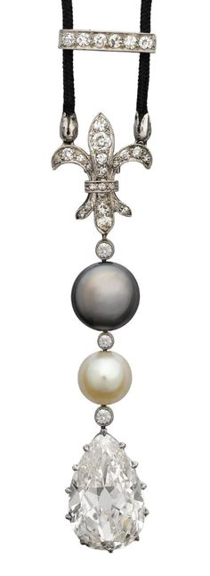 A belle époque pearl and diamond pendant, circa 1905  The fleur-de-lys surmount millegrain-set with old brilliant and single-cut diamonds, suspending a grey and a white pearl connected by millegrain-set old brilliant-cut diamond spacers, terminating in an old pear-shaped diamond drop, weighing 6.97 carats, on a black cord necklace with an adjustable single-cut diamond slide, pendant length 6.0cm.