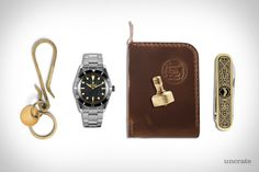 """Taylor Stitch Raw Brass Keyhook ($32). 1954 Rolex """"No-Submariner"""" Watch ($48,000). Rogue Territory Ewing Dry Goods Wallet ($175). J. L. Lawson & Co. Mini EDC Top ($38). 1960's Vintage Pocket Knife ($137)...."""