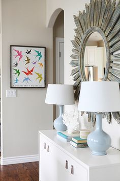 Salt Lake City refined, rustic, cozy & bright dining room designed by Jana Bek Design.   Follow us on Facebook at Jana Bek Design, on instagram @Jana Bek Design, & at www.janabek.com   Alice Lane Home, sunburst mirror, buffet console styling, West Elm, Ballard Designs, coral