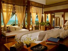 White Bed Overlooking Awesome Sea View Through Opened Window With Creamy Curtains / White Appealing Luxurious Tanjong Jara Resort In Malaysia