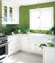 Green subway tiles and that sink.