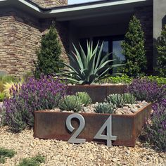 A two-tier Corten steel planter featuring the sculptural Weber Agave. Designed and Built by Silver Lands Inc.