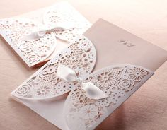 White paper craft Etsy listing at https://www.etsy.com/listing/162375469/delicate-white-laser-cut-floral