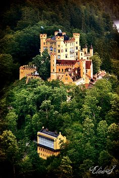 "hohenschwangau castle, germany--this castle is across the ""street"" from neuschwanstein castle (the 'disney castle')"