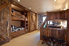 Bunk beds and sliding barn doors in the rustic bedroom