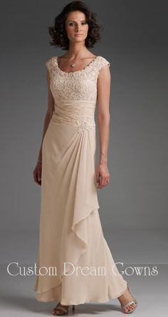 Cameron Blake 110619 is a Beautiful A-Line Chiffon Gown with Scoop Neckline, Cap Sleeves, Elegant Lace Embroidered Bodice, Ruched Waist Adorned by a Beaded Motif, Layered Cascading Mock Drape on Floor Length Skirt. Gorgeous Mother of the Bride Dresses Professionally Custom Made to Your Exact Measurements.