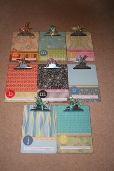 These scrapbook paper & mod podge clip boards would make great teacher gifts.