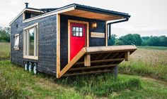 tiny house offers reclaimed style and drawbridge deck The off-grid tiny house on wheels is now available to order.The off-grid tiny house on wheels is now available to order. Tiny Mobile House, Off Grid Tiny House, Best Tiny House, Modern Tiny House, Tiny House Living, Tiny House Plans, Tiny House Design, Tiny House On Wheels, Mobile Home