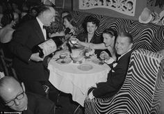 Bubbly John Perona, right, the owner of El Morocco nightclub on E. 54th Street celebrates New Year's Eve with guests in 1951 with an absurdly large bottle of champagne.
