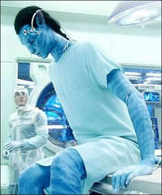 Waking up as a na'vi must have been amazing for jake because he's not just huge, he has legs! this scene still makes me cringe though when he pulls out his iv's and whacks that guy with his tail