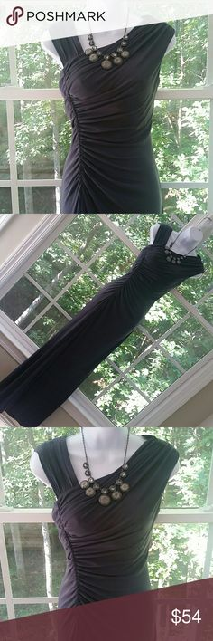 "Calvin Klein Beyond Elegant Evening Gown Absolutely sexy, beautiful, gorgeous, and beyond elegant evening gown from Calvin Klein.   ◾Charcoal Grey  ◾Elegant neckline and back  ◾Side gathered and pleated making it extremely figure flattering  ◾Differentiating shoulder styles add to the elegance and style ◾95% Polyester, 5% Spandex. Dry clean only.  ◾Side zipper closure  ◾Bust 19"" Waist 14"" Hips 18"" Length 60"" ◾Excellent condition, no issues   Please let me know if you have any questions…"