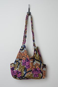 Like our Signature Hobo, but with a funky twist, the Twisted Hobo comes in two gorgeous African prints. The purse body is slouchy with two outside pockets and one interior, with two twisted straps. Made by artisans in Uganda $28