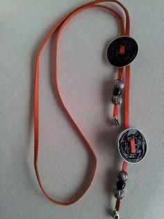 Collar étnico naranja y negro 5,99€