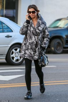 Low profile: She is widely considered one of the most beautiful women in the world, but Elisabetta Canalis cover up her fabulous figure as she stepped out in Los Angeles on Friday