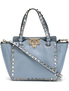 Shop Valentino Garavani 'Rockstud' trapeze tote in Apropos The Concept Store from the world's best independent boutiques at farfetch.com. Shop 300 boutiques at one address.