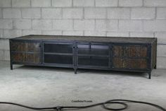 """This is a beautiful media console from our """"Woodrow series. It is a very versatile piece that functions perfectly as a credenza, buffet, sideboard, etc. I have already delivered this one to a client, but I'd love to make one for you. There are many options available for this piece. The price"""
