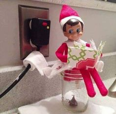 Elf poop in mason jar- use a Christmas Hersey kiss. Put it in bottom of mason jar put elf in the sitting position and some toilet paper Christmas Activities, Christmas Traditions, A Shelf, Shelves, Shelf Elf, Elf On Shelf Funny, Elf On Shelf Names, Awesome Elf On The Shelf Ideas, Elf On The Shelf Ideas For Toddlers