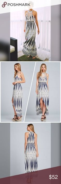 Nahla Maxi Dress Woven Open Shoulder Maxi Dress. All over geometric print. Embroidery appliqué crested at chest. Spaghetti cord tie at back next. Split skirt in front. Elasticize skirt. Skirt lined with 100% Polyester lining. Dresses Maxi
