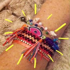 MULTI LAYERED MAGNETIC CLOSE BRACELET Shells, beads, ribbon, rhinestones, cord, fabric trim, tassels and enamel painted metal eye pendant......all in one stylish bracelet. 7 1/4 inches layed out. Jewelry Bracelets