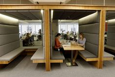 """Rachel Constable (left) and Vanessa Slavich work in a """"cabana"""" at Square…"""